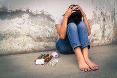 Drug addiction in adolescence. Concept Asia young girl is sad by drug addiction. Drug addiction in adolescence Stock Image