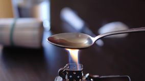 Drug dependence of man. Drug addiction. Cooking Heroin on a spoon stock footage