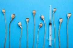 Drug addiction and its treatment. Opium drugs, opiate and heroin on blue background stock images
