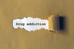 Drug addiction. On white paper stock image