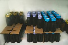 drug bottles on shelf in store or factory or hospital clinic Stock Image