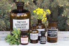 Drug bottles. Vintage drug bottles on wooden board Stock Images