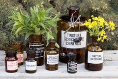 Drug bottles. Vintage drug bottles on wooden board Stock Photo