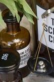 Drug bottles. Vintage drug bottles on wooden board Stock Photography
