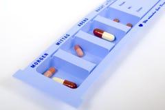 Drug box. A drug box serves the organisation of drug dosages Stock Photos