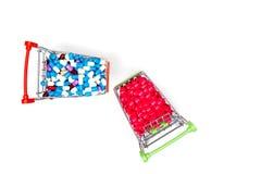 Drug capsule on mini cart Royalty Free Stock Photo