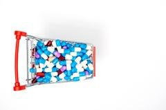 Drug capsule on mini cart Stock Image