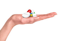 Drug capsules and pills in hand Royalty Free Stock Image