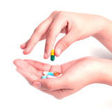Drug capsules and pills in hand Royalty Free Stock Photos