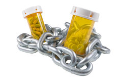 Drug chain. Pills and capsules encased and surrounded by chain. Isolated with work path Stock Images