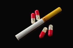 Drug and a cigarette Royalty Free Stock Photography