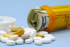 Drug Costs. Photo of Pills and Pill Bottle With Money.  Drug Cost Concept Royalty Free Stock Images