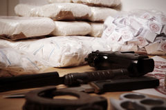 Drug criminality. Drug packages, raw opium, drug dozens and weapons seized by police Royalty Free Stock Photo