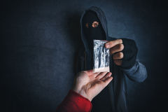 Drug dealer offering narcotic substance to addict on the street Stock Images