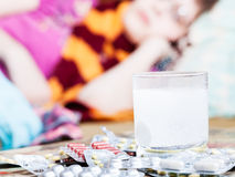 Drug dissolves in water and pill on table close up Royalty Free Stock Photo