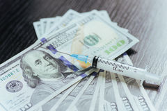 Drug, dollar, money, addiction and substance abuse concept - clo Stock Image