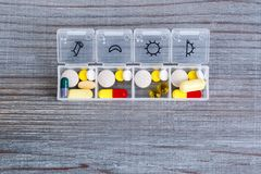 Daily drug dose. Pills organized in a pill box Royalty Free Stock Photo