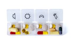 Daily drug dose. Pills organized in a pill box royalty free stock images
