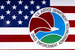 Drug Enforcement Administration Seal and US Flag. LONDON, UK - MARCH 27TH 2018: The seal or symbol of the Drug Enforcement Administration of the US Justice Royalty Free Stock Photos