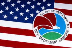 Drug Enforcement Administration Seal and US Flag. LONDON, UK - MARCH 27TH 2018: The seal or symbol of the Drug Enforcement Administration of the US Justice Royalty Free Stock Photography