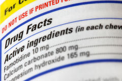 Drug facts label. Extreme close up shot of Drug facts label on medicine bottle stock images