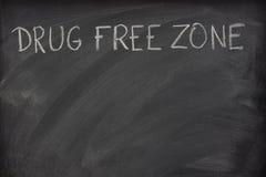 Drug free zone text on a school blackboard stock photos