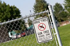 Drug and gun free school zone. Sign at a school yard. sign of the times Stock Images