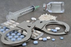 Drug and handcuffs stock image