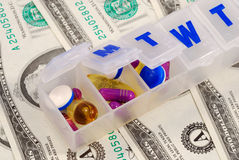Drug holders on some dollar bills. Concepts of rising medical cost Stock Photo