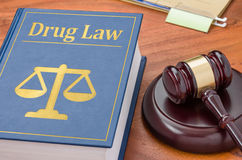 Drug law. A law book with a gavel - Drug law stock photos