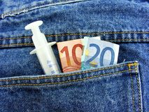 Drug money in back pocket Stock Photo