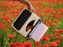 Drug, narcotics, opium, novel. Opium poppy, agile business, ecology. Vintage typewriter in hand, education, business, grammar Poppy new technology Remembrance stock photography