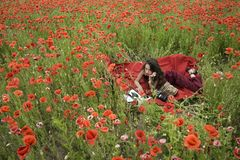 Drug, narcotics, opium, woman with typewriter, camera, book. Opium poppy, agile business, ecology. Poppy, Remembrance or Anzac Day. Woman writer in poppy stock images