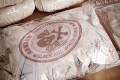 Drug packages - detail. Drug packages, raw opium, drug dozens and weapons seized by police Stock Images