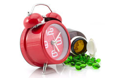 Drug pill. Bottle and alarm clock,times to takecare yourself Stock Photo