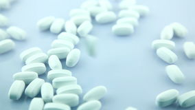 Drug Pills Pouring On Surface Royalty Free Stock Photography