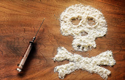 Drug powder cocaine in silhouette of the skull Stock Images