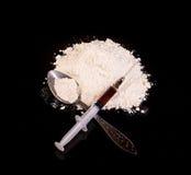 Drug powder, drug syringe and drug on spoon close-up Stock Images