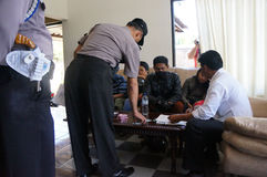 Drug raid. Police conducted a drug raid at a motel in Karanganyar, Central Java, Indonesia to suppress crime Stock Photography