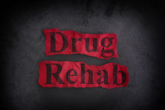 Drug Rehab Concept. Torn crumpled pieces of paper with the words Drug Rehab. Concept image Stock Images