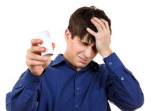 Drug Side Effect. Young Man with the Bottle of the Medical Product feels Unwell Royalty Free Stock Image