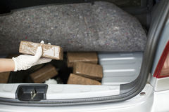 Drug smuggling. Drug packages smuggled in a vehicle's trunk Stock Image