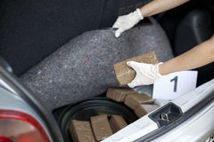 Drug smuggling. Drug packages smuggled in a vehicle's trunk Royalty Free Stock Photos