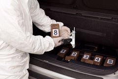 Drug smuggling. Drug bundles smuggled in a car trunk. Illegal drug trade Royalty Free Stock Photography