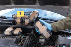 Drug smuggling in a car engine compartment. Hidden drugs in a vehicle compartment Stock Image