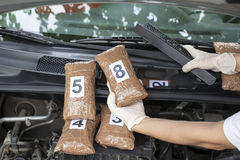Drug smuggling. Drug smuggled in a car's engine compartment Royalty Free Stock Photos
