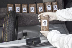 Drug smuggling. Drug smuggled in a car trunk Stock Photo