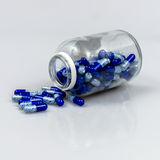 Drug spill. Bottle white isolated background cap open royalty free stock images