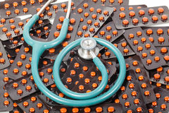 Drug and stethoscope Stock Images