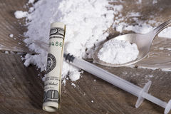 Drug syringe and cooked heroin. Photo Drug syringe and cooked heroin Royalty Free Stock Images